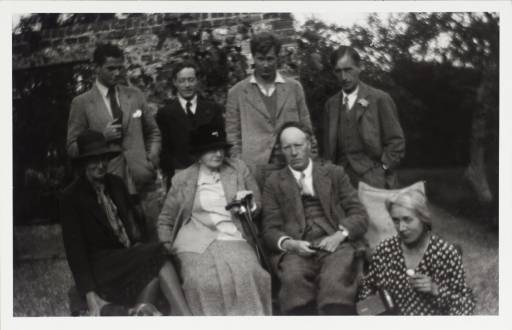 Garden party at Charleston, standing from left to right are Angus Davidson, Duncan Grant, Julian Bell and Leonard Woolf. Seated are Virginia Woolf, Margaret Duckworth, Clive and Vanessa